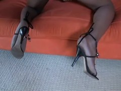 Beautiful black tranny poses on sofa from thebestshemales.com